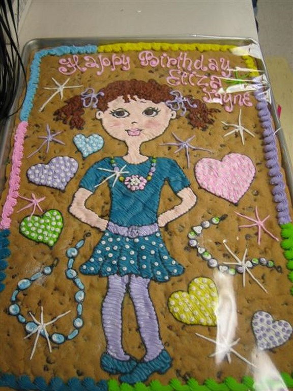 GIRL ON COOKIE CAKE